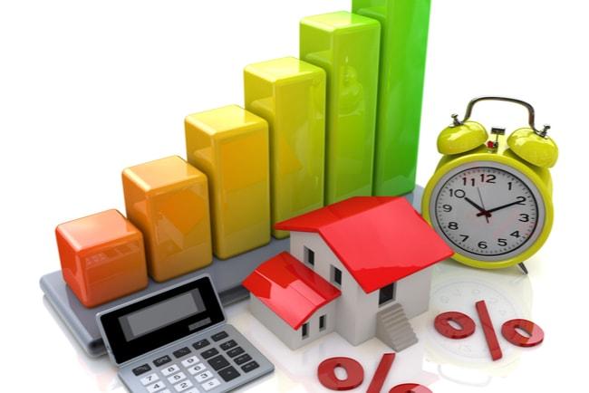 Illustration av diagramstaplar, miniräknare, hus, klocka och procenttecken